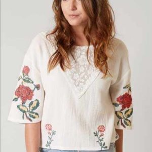 Buckle Gimmicks adorable white cross-stitch top